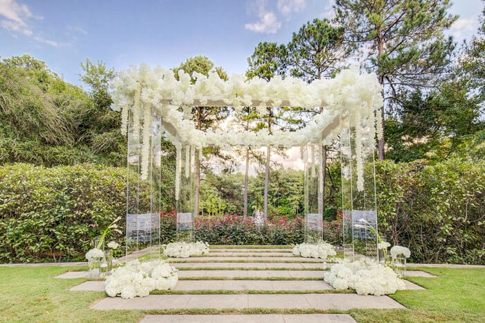 Wedding ceremony arbor with floating white flowers at The Umstead Hotel and Spa