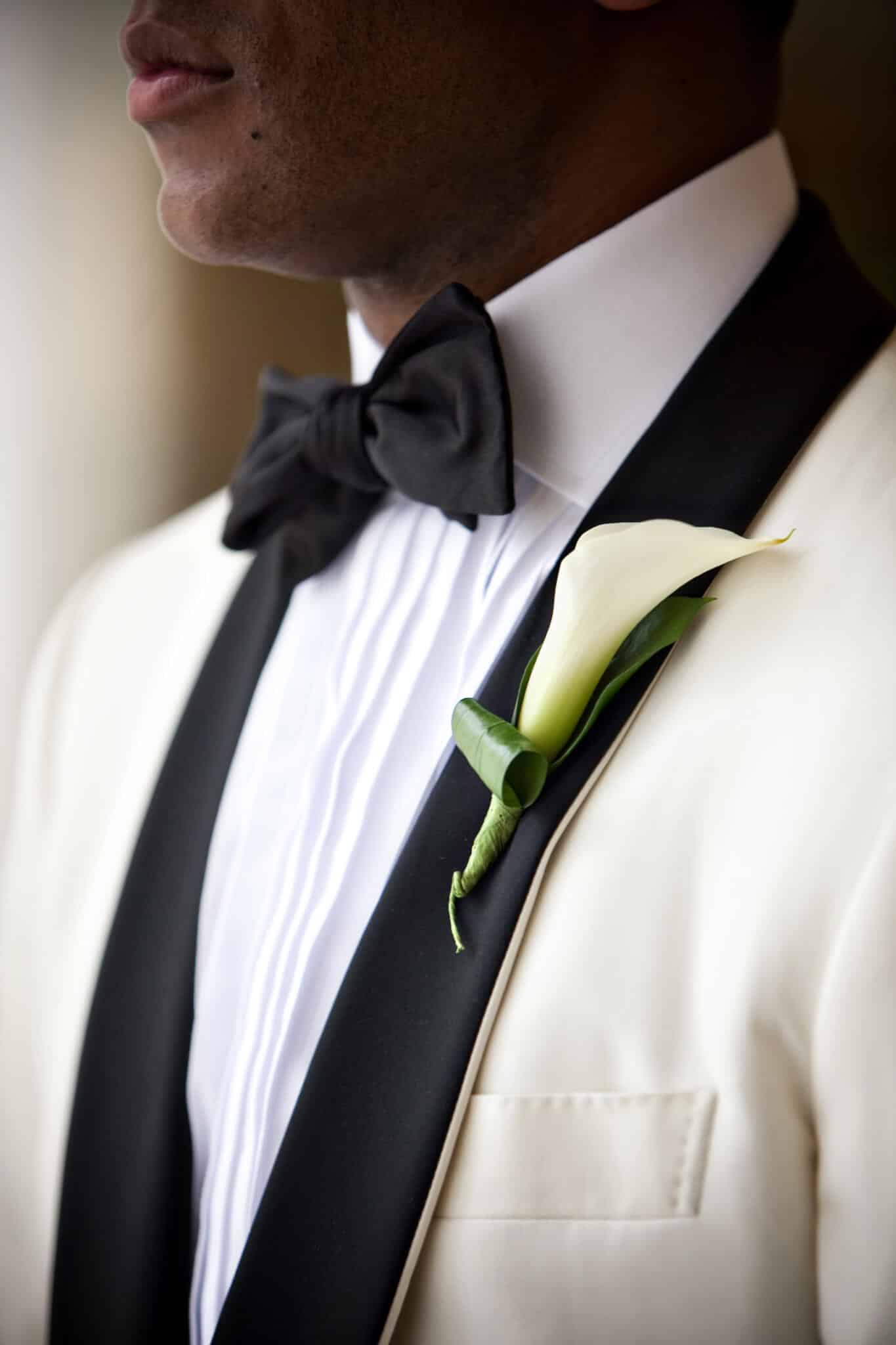 Groom wearing calla lily boutonniere