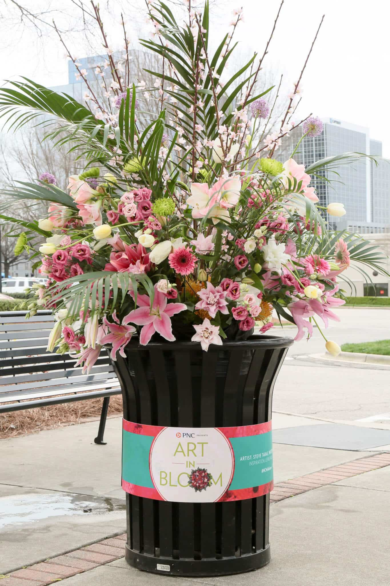 Pink trashcan bouquet in North Hills for NMCA Art In Bloom