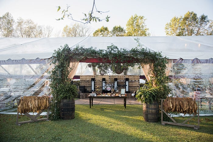Greenery tent entry at outdoor fall wedding