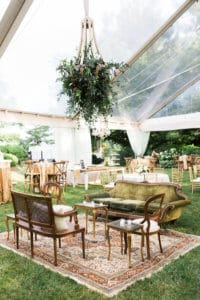 Greenery chandelier at a tent wedding reception