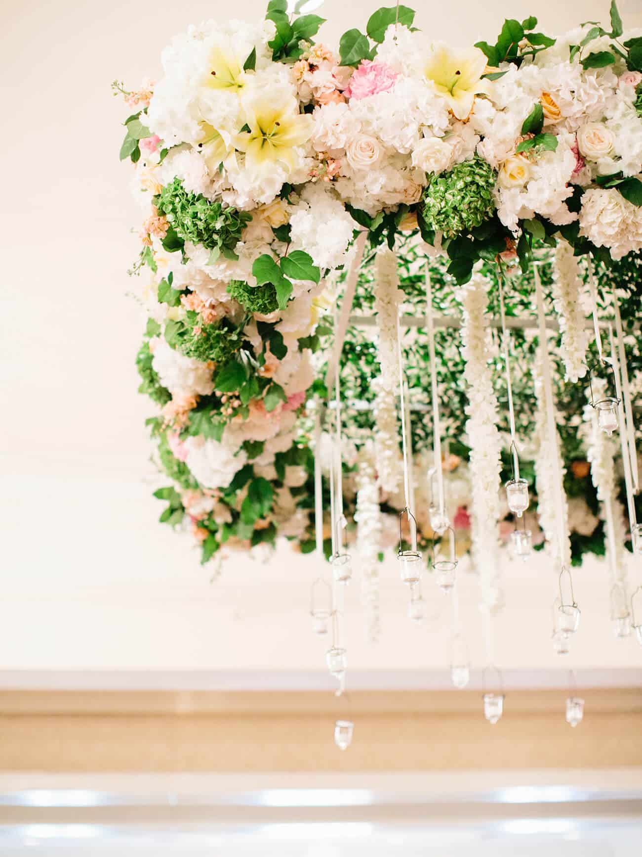 Floral chandelier with lilies and leis