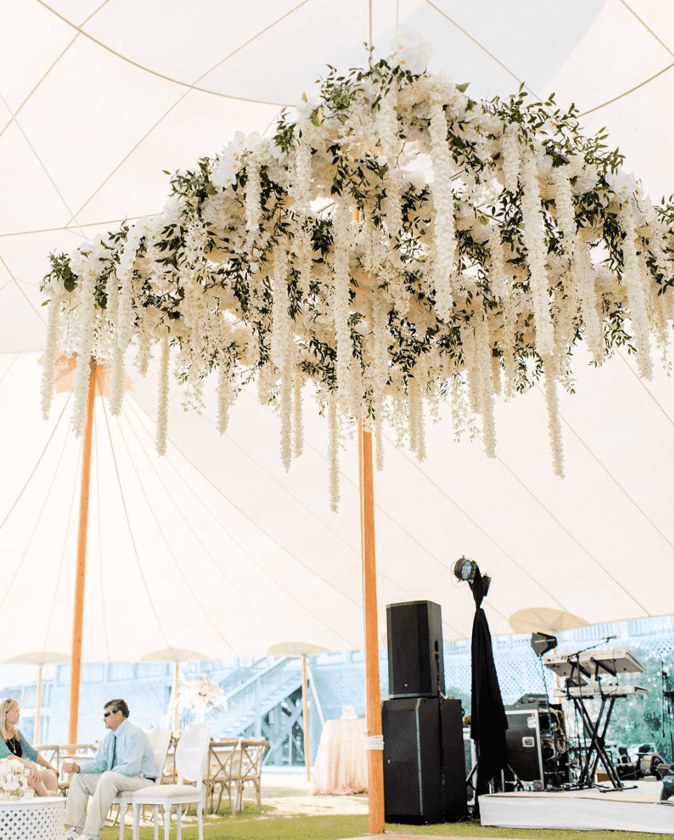 Wedding reception structure with hanging white flower leis