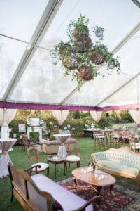 Floating grapevine balls with greenery at a tent wedding reception