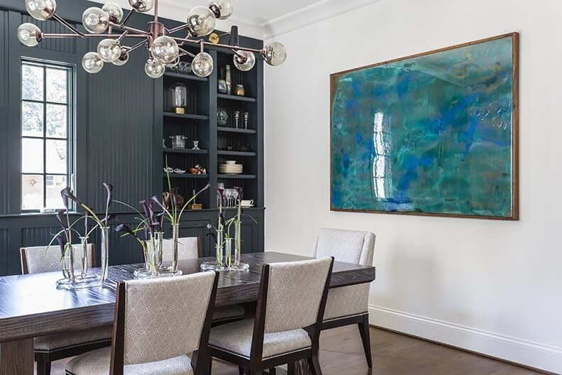 Modern dining room with black calla lily floral arrangement