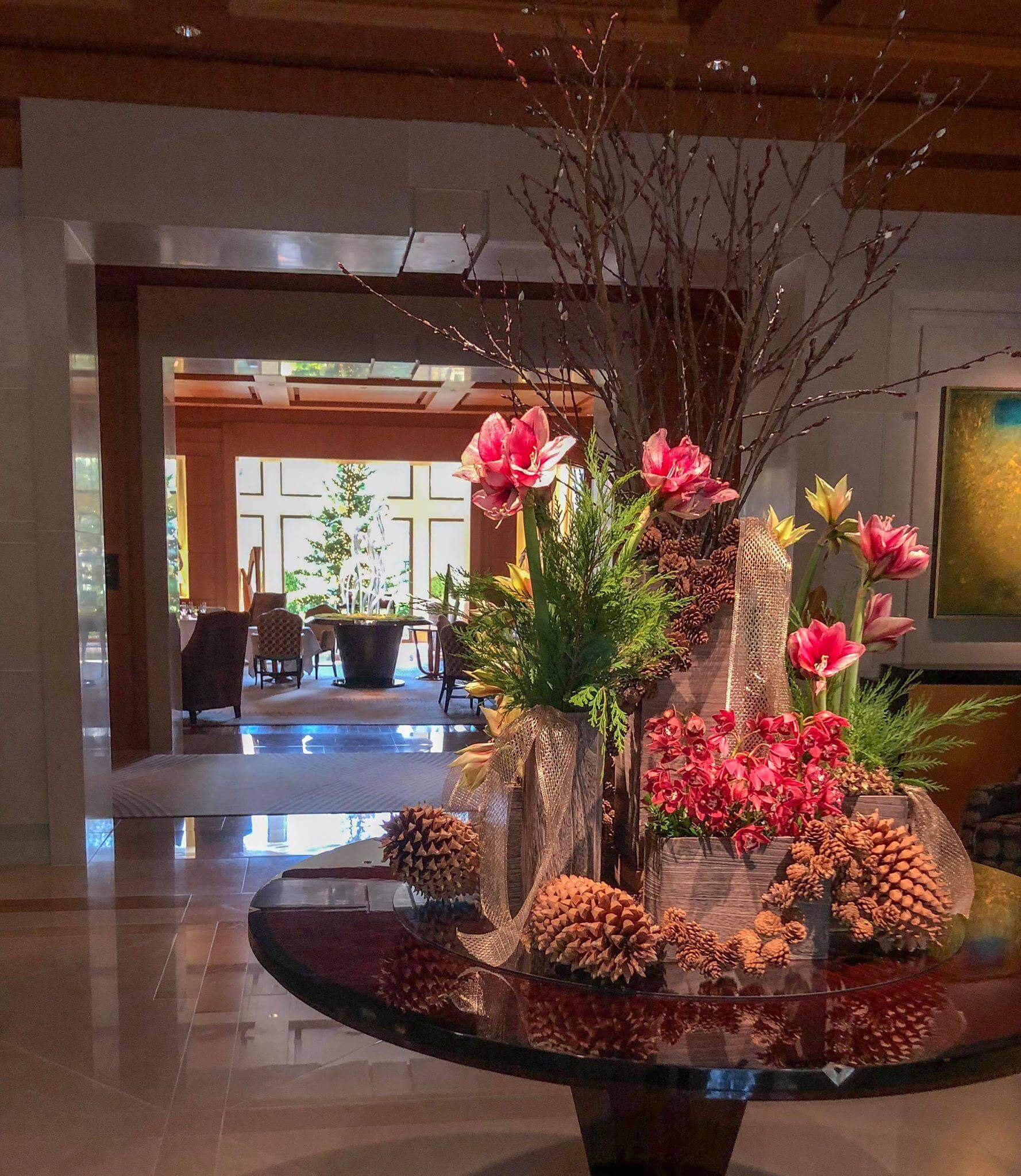Holiday decor with amaryllis and pinecones at The Umstead Hotel and Spa
