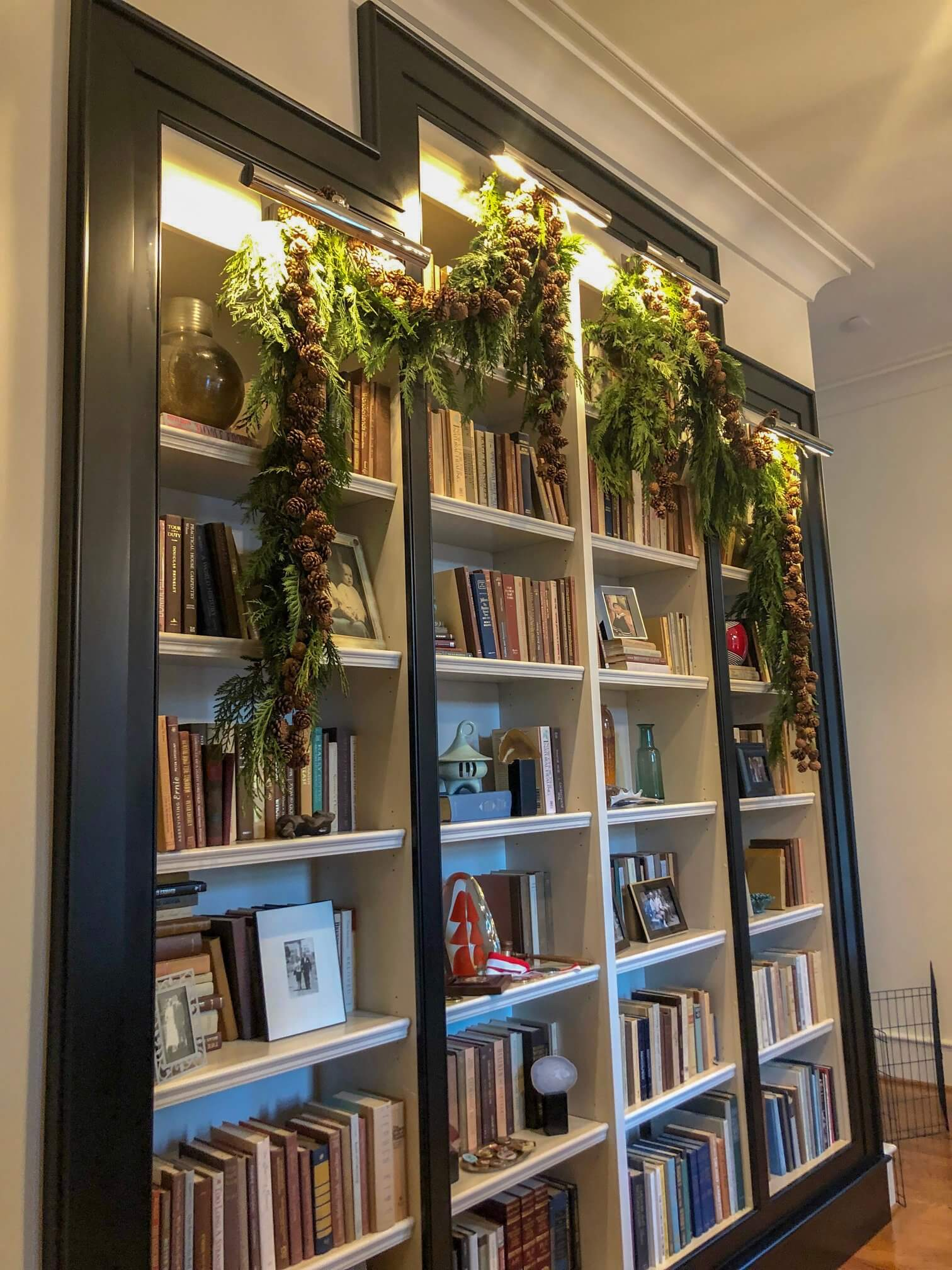 Residential holiday installation with pinecones and greenery