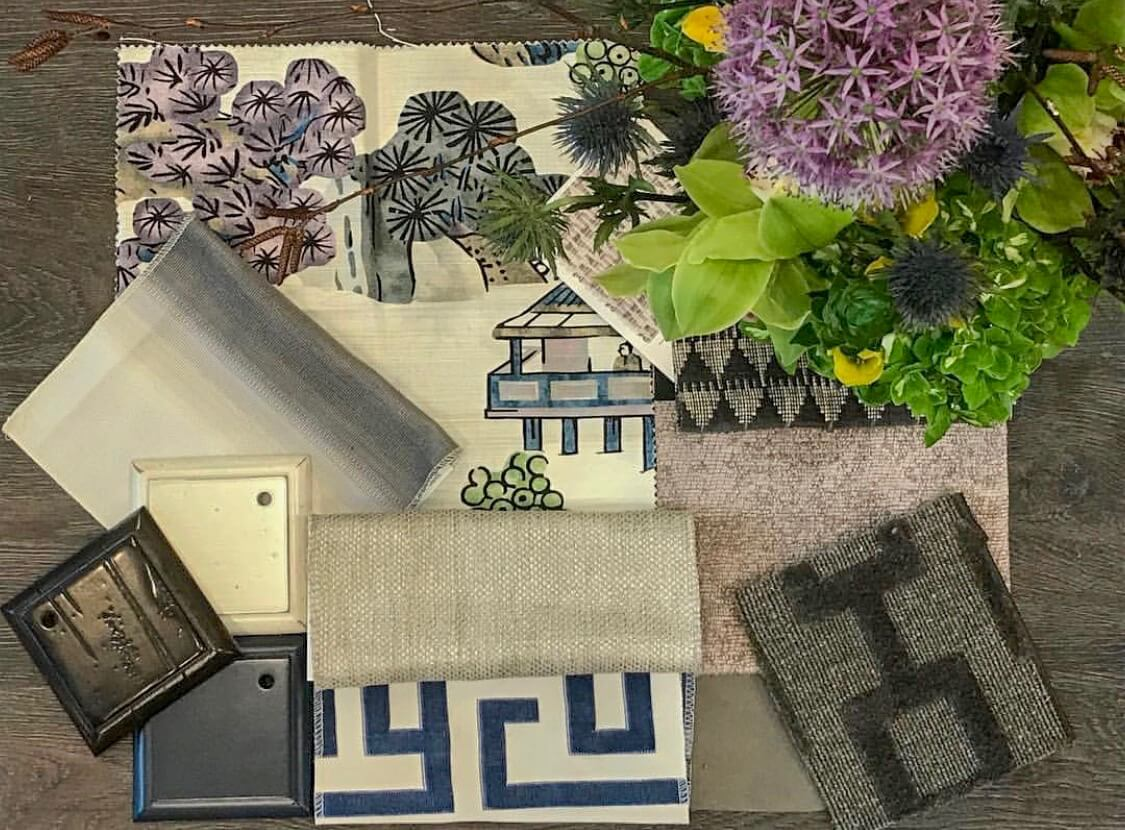 Floral arrangement and fabric swatches